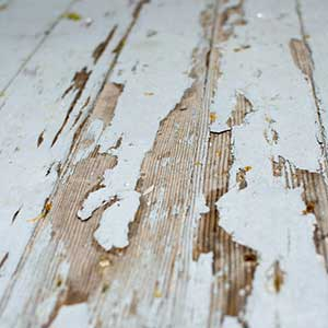 Scrapping of Old Paint and Sanding